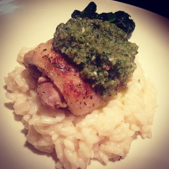 Pan-fried garlic chicken with green salsa served on lemon risotto