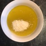 Combine extra olive oil, lemon juice and parmesan
